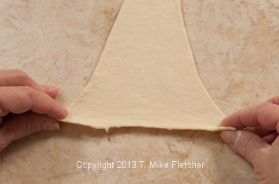 Stretching top of dough for roll