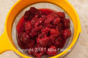 Raspberries in strainer