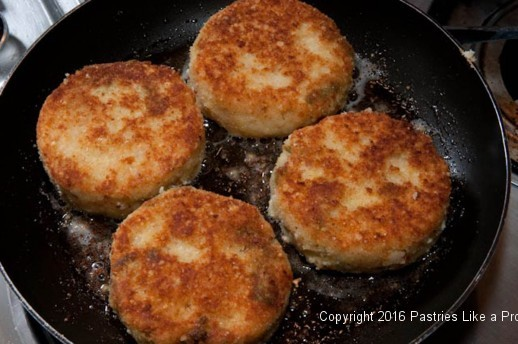 Frying risotto cake for the Lemon Asparagus Risotto Cakes