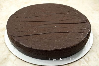Ultimate Chocolate Fudge Cake baked on a board