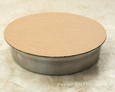 Cake board on top of pan