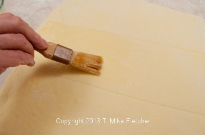 Brushing center with butter
