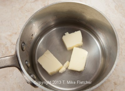 Water, butter & salt in pan