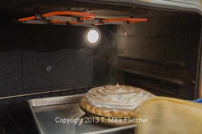 Removing pie from oven