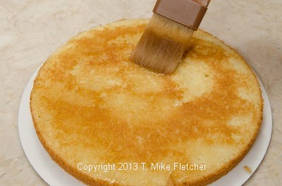 Brushing cake layer with syrup