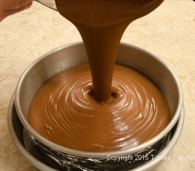Pouring Triple Chocolate Cheesecake into pan