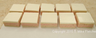 Ten three inch squares of wedding cakes