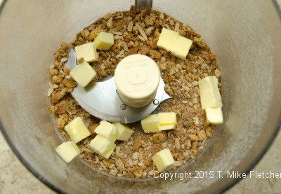 Butter in processor with amaretti crumbs to be processed for Baked Pluots with Amaretti Crumble