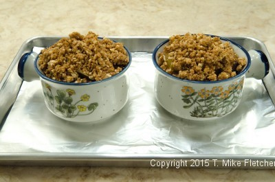 Casseroles topped with amaretti crumbs for Baked Pluots with Amaretti Crisp