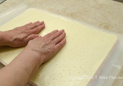 Smoothing the top layer of the wedding cakes