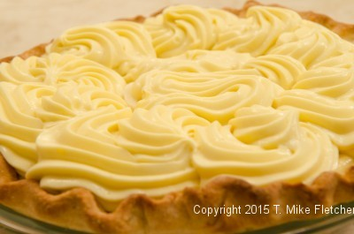 Pastry Cream piped completely over the bananas for the Double Banana Caramel Cream Pie