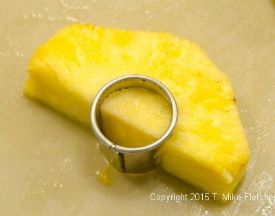 Cutting core out of pineapple for the Pina Colada Cake