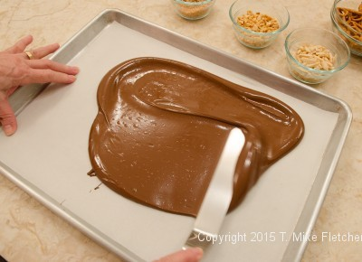 Chocolate being spread for TJ's Cowboy Bark