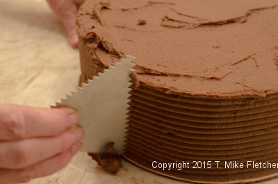 Combing the side of the Double Chocolate Mousse Cake