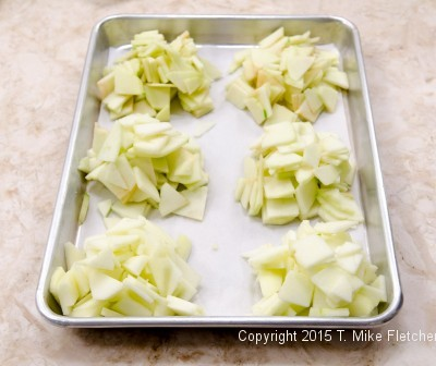 Piles of apples on a tray for Apple Crostatas with Pastry Cream
