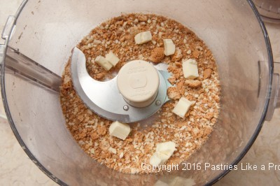 Butter in processor for the Roasted Peaches with Amaretti Crisp