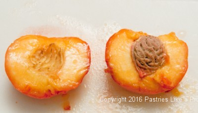 Pit removed from the peach for the Roasted Peaches with Amaretti Crisp