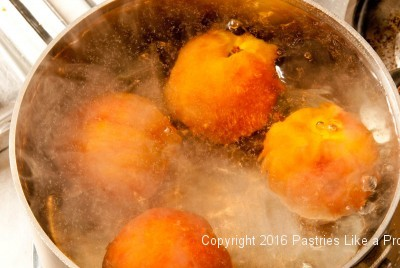 Peaches boiling for Roasted Peaches with Amaretti Crisp