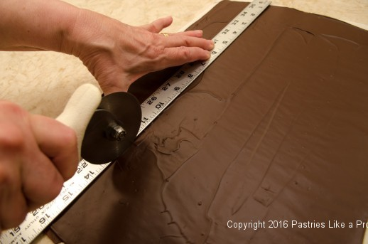 Cutting the chocolate into panels for the Chocolate Rasperry Gateau