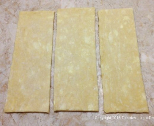 Pastry cut into 3 pieces for Chocolate Raspberry Pop Tarts