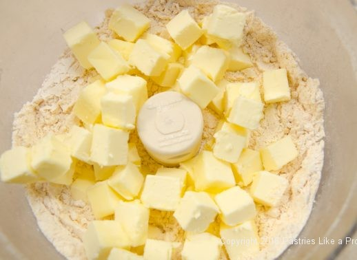 Butter in processor for the Cheddar Pecan Shortbreads