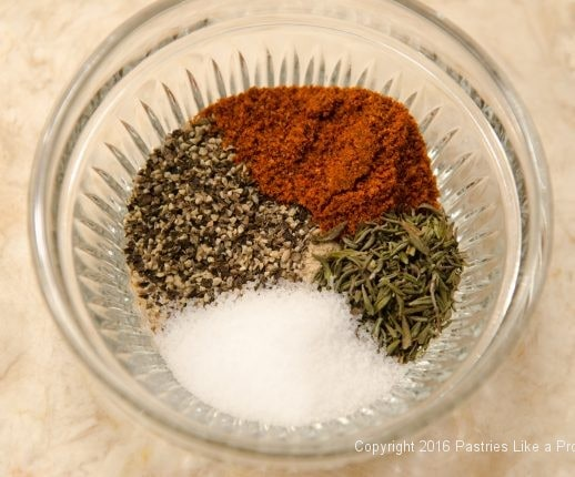 Spices in a bowl for the Hot Peppered Pecans