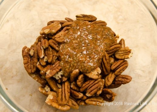Spices on pecans for the Hot Peppered Pecans