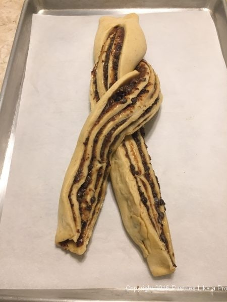Twisting dough for the Brandied Chocolate Cherry Almond Filling