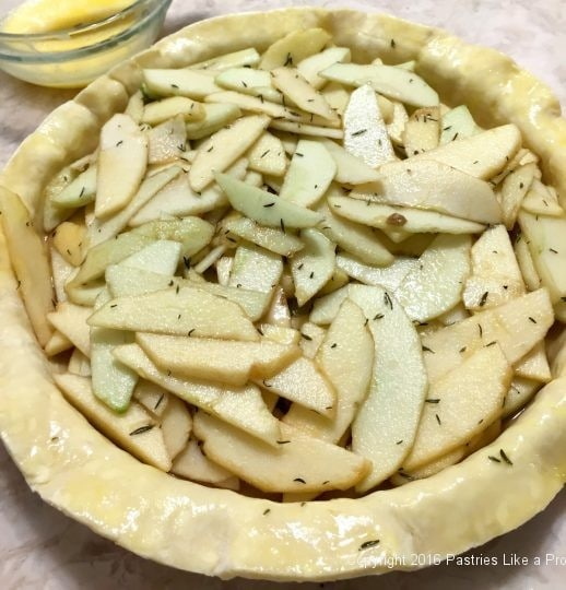 Edge of pastry washed for the Honey Thyme Apple Tart