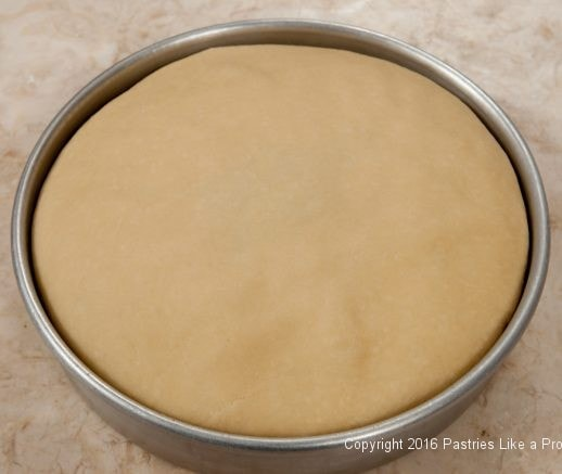 Pastry flattened in pan for the Torta Rustica