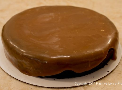 Caramel on cake for the Decadent Gluten Free Turtle Cake