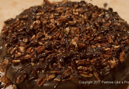 Chocolate drizzled on for the Decadent Gluten Free Turtle Cake