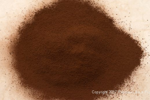 Sifted cocoa for the Decadent Gluten Free Turtle Cake