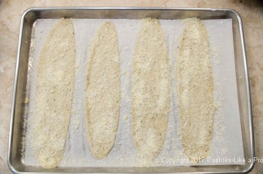 Sprinkled with parmesan cheese for Garlic Oregano Cracker Bread
