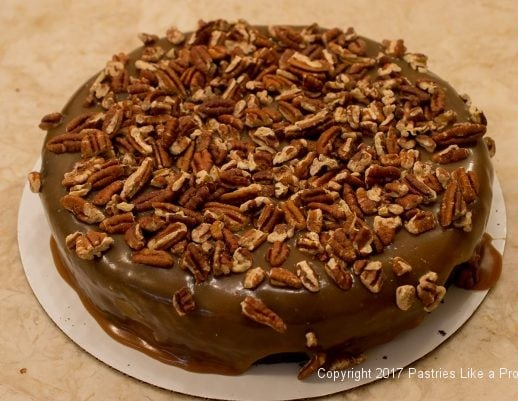 Pecans on the caramel for the Decadent Gluten Free Turtle Cake