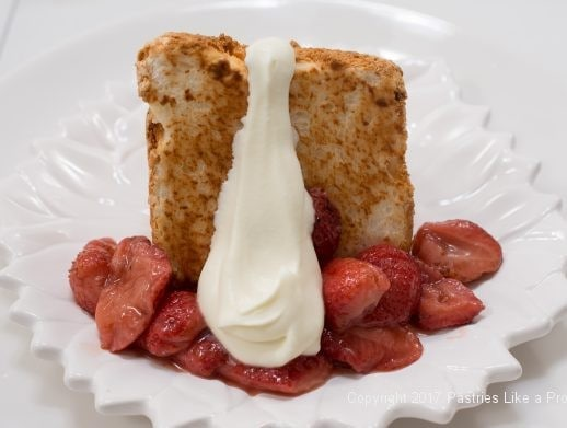 Cream on cake for Toasted Angel Food Cake with Roasted Strawberries