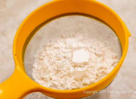 Sifting flour for the Chocolate Raspberry Marzipan Gateau