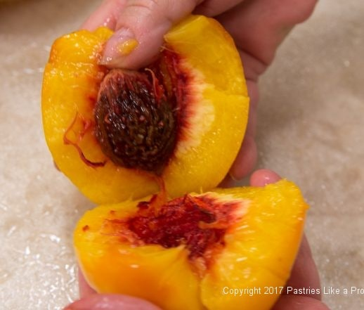 Pulling peach apart for the White Wine and Amaretto Peach Sauce