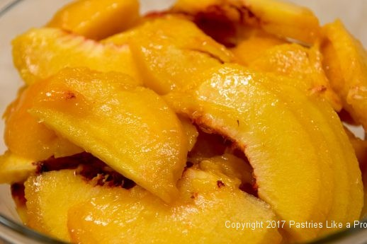 Sliced peaches for the White Wine Amaretto Peach Sauce