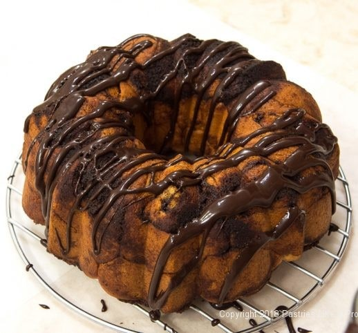 Drizzling glaze on the Chocolate Spiced Coffee Cake