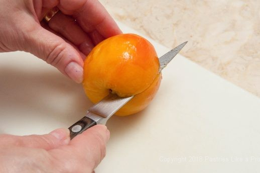 Cutting a each for Everything Peaches