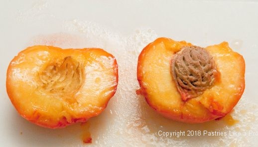 Open peach with a stone for Everything Peache