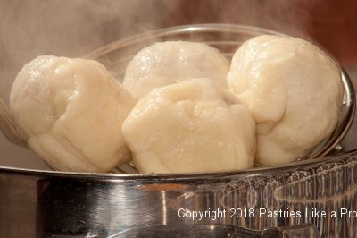 Dumplings coming from water for Plum Dumplings