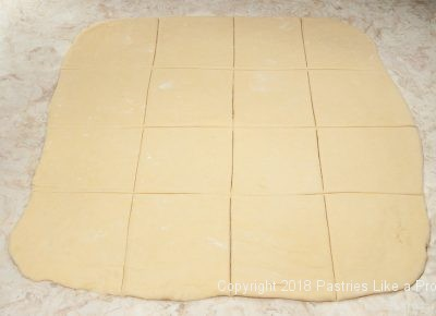 Dough cut into squares for Plum Dumplings