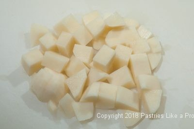Cut potatoes for Plum Dumplings