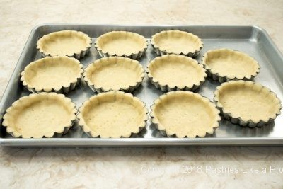 Unbaked tray of tart shells for Browned Butter Tarts