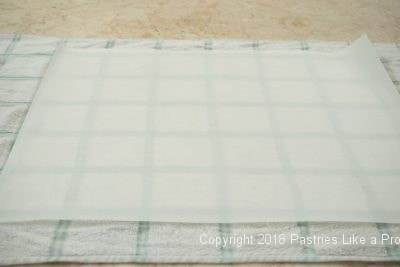 Parchment on towel for Traditional Apple Strudel