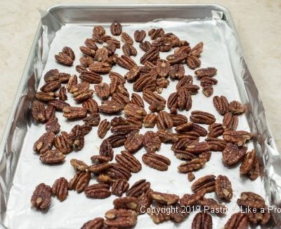 Pecans on baking sheet for Maple Pecans