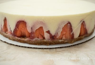 Pastry cream on strawberries for Vanilla Mousse Torte with Strawberries