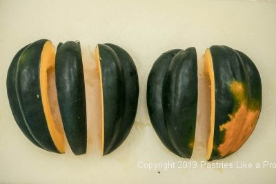 Acorn squash sliced before cleaning